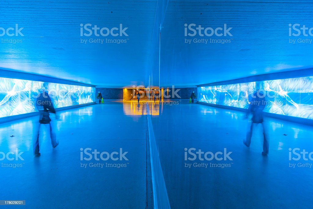 tunnel with pedestrians in motion royalty-free stock photo