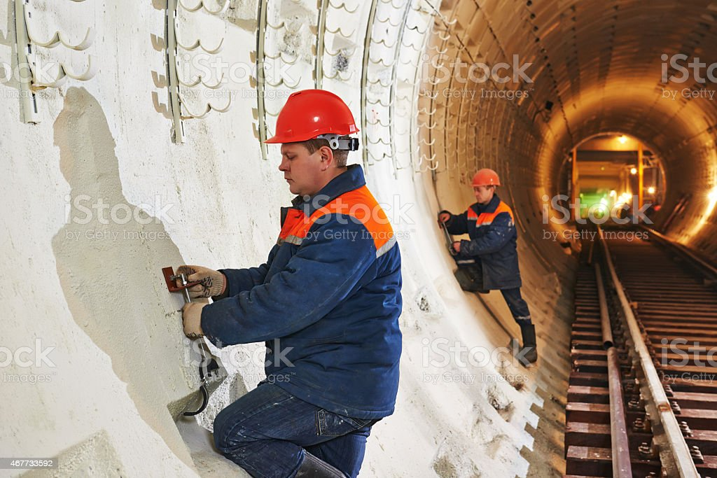tunnel worker at underground construction site stock photo
