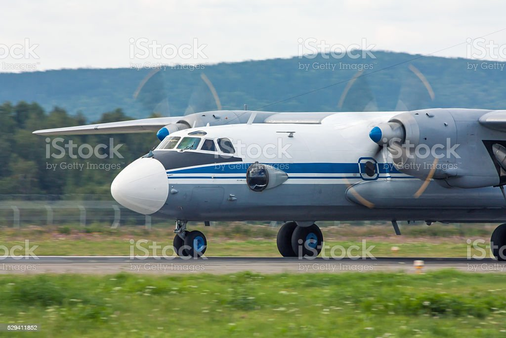Turboprop aircraft heading on the runway royalty-free stock photo