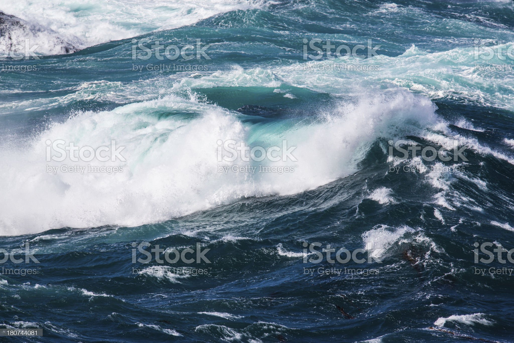 Turbulent ocean waves on rocky waters royalty-free stock photo