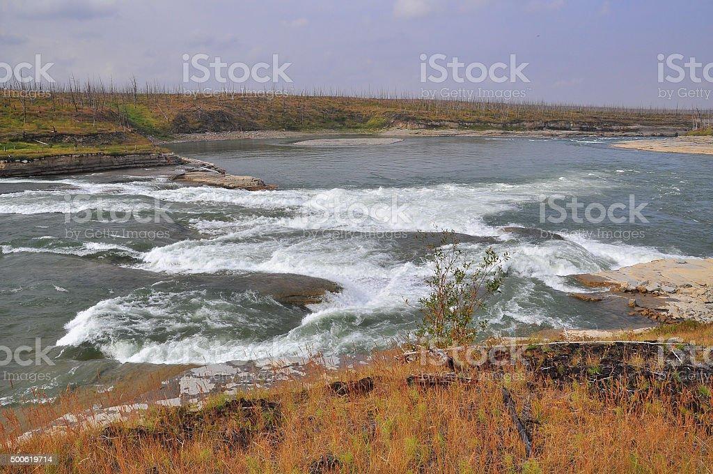 Turbulent rapids on the river. stock photo