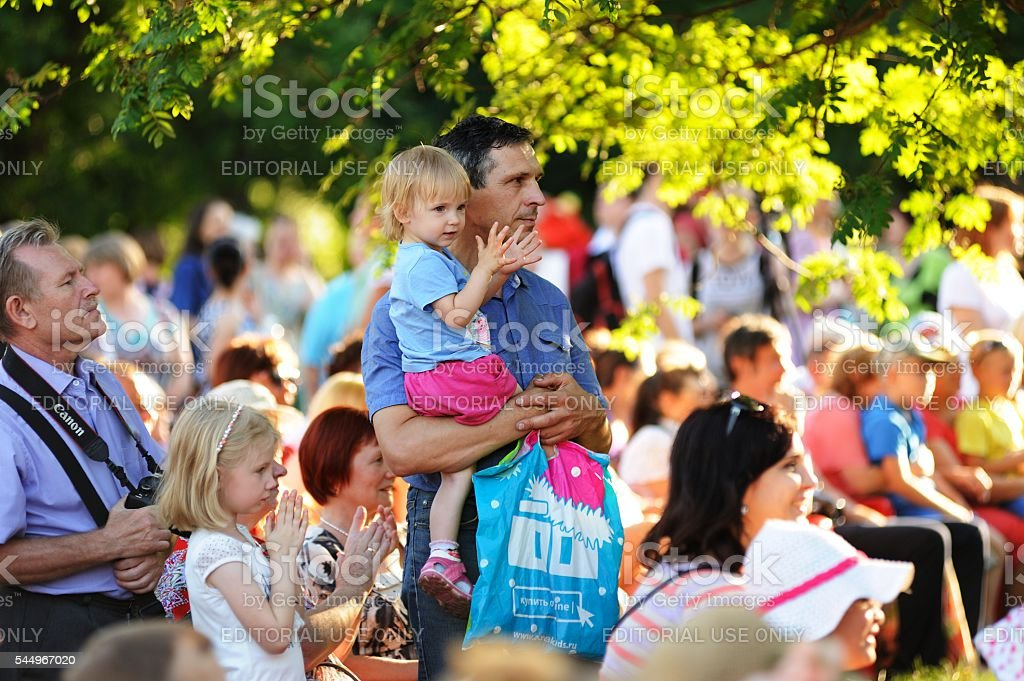 Turgenev Fest. Spectators watching play under sunlit trees stock photo