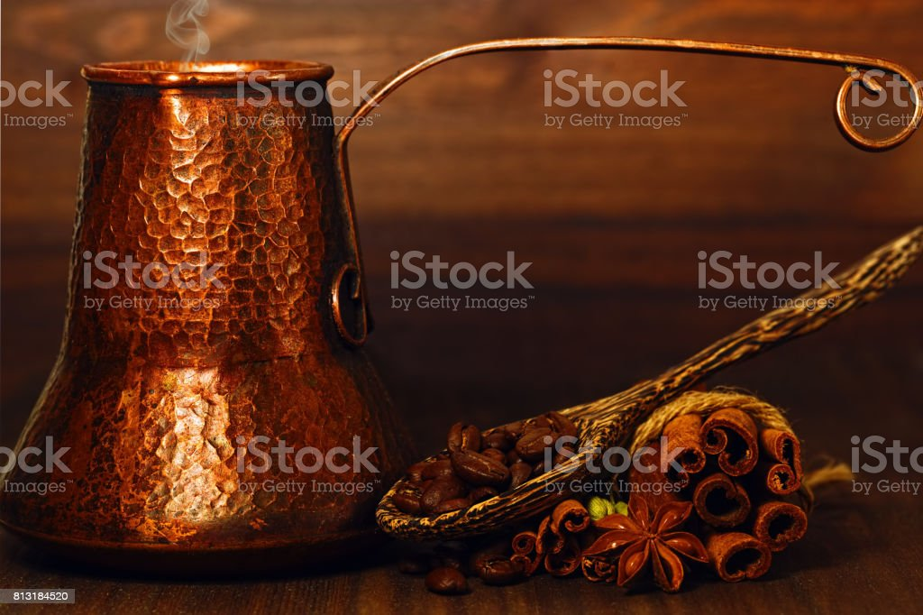 Turk coffee pot and coffee beans with spices on the table stock photo