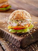 Turkey and Cheese Sandwich on a Rustic Cutting Board