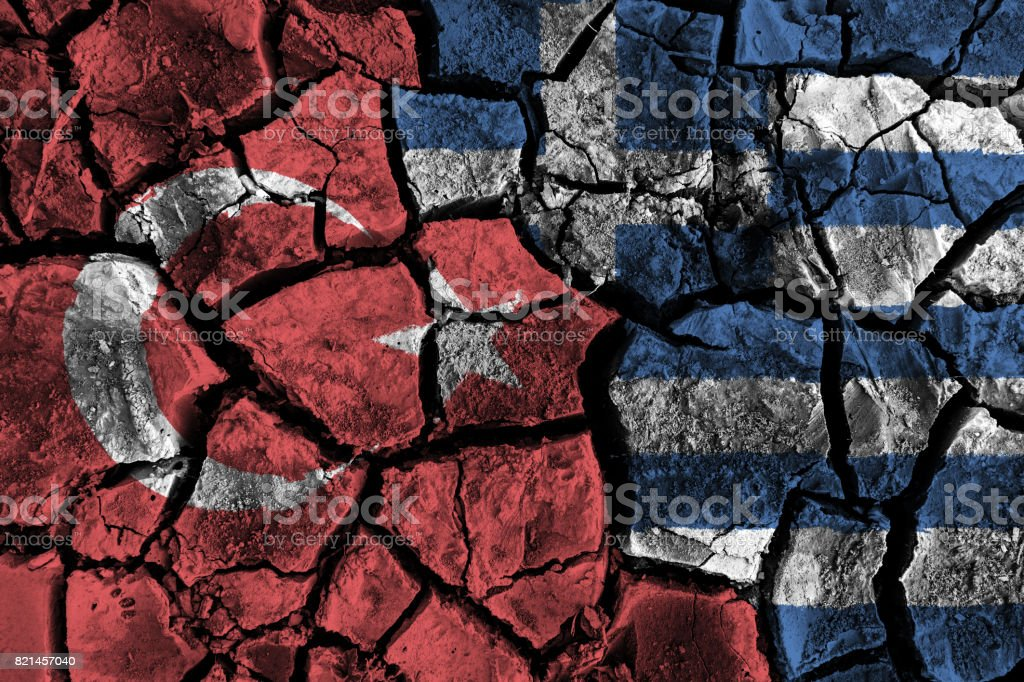 Turkey and Greece flag on cracked ground . Confliction and crisis concept . stock photo