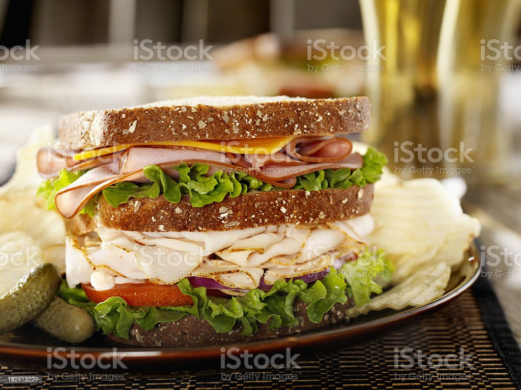 Turkey and Ham Sandwich with a Beer royalty-free stock photo