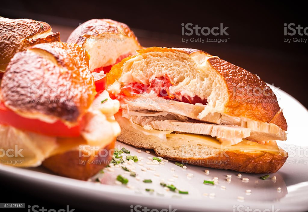 Turkey breast sandwich on plate stock photo