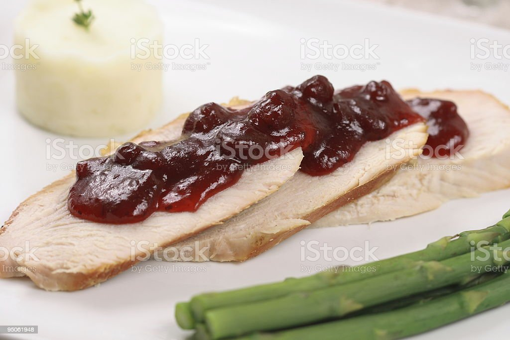 Turkey breast topped with cranberry sauce royalty-free stock photo