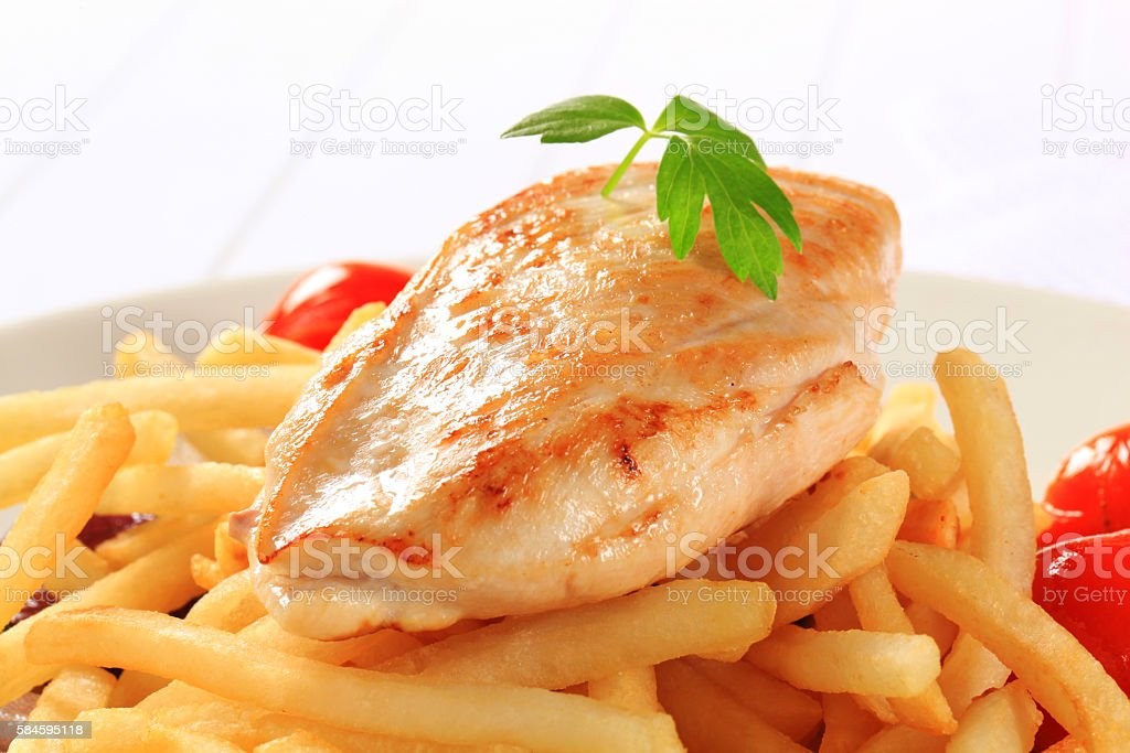 turkey breasts and french fries stock photo