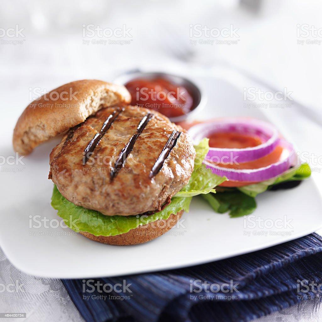 turkey burger on table top stock photo
