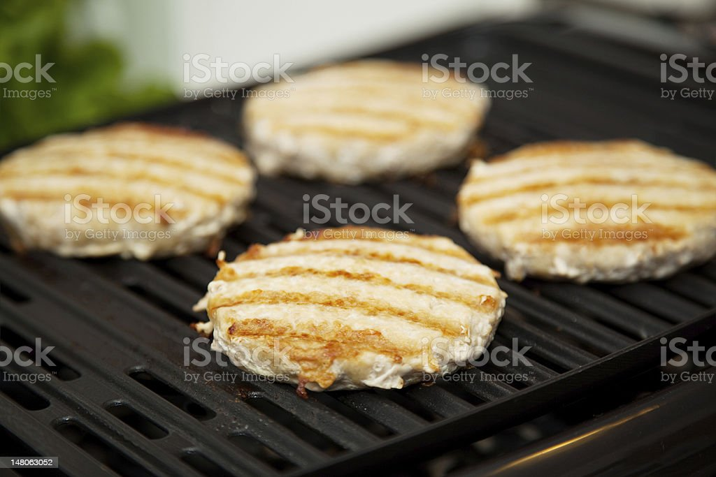 Turkey Burgers on the Grill royalty-free stock photo