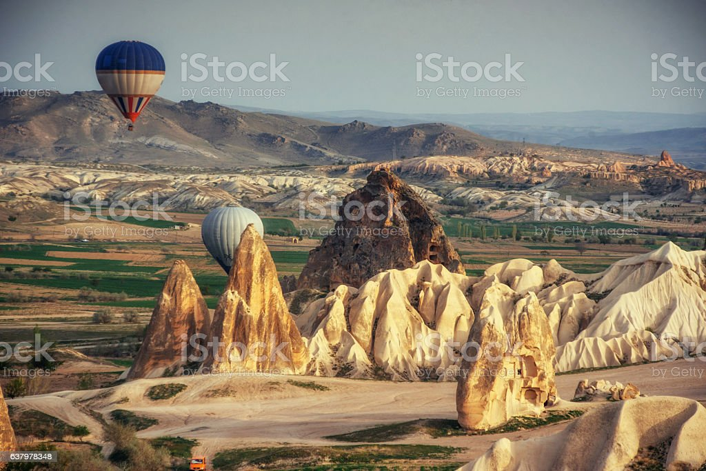 Turkey Cappadocia beautiful balloons flight stone landscape stock photo