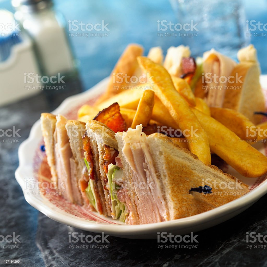 Turkey Club Sandwich with fries royalty-free stock photo