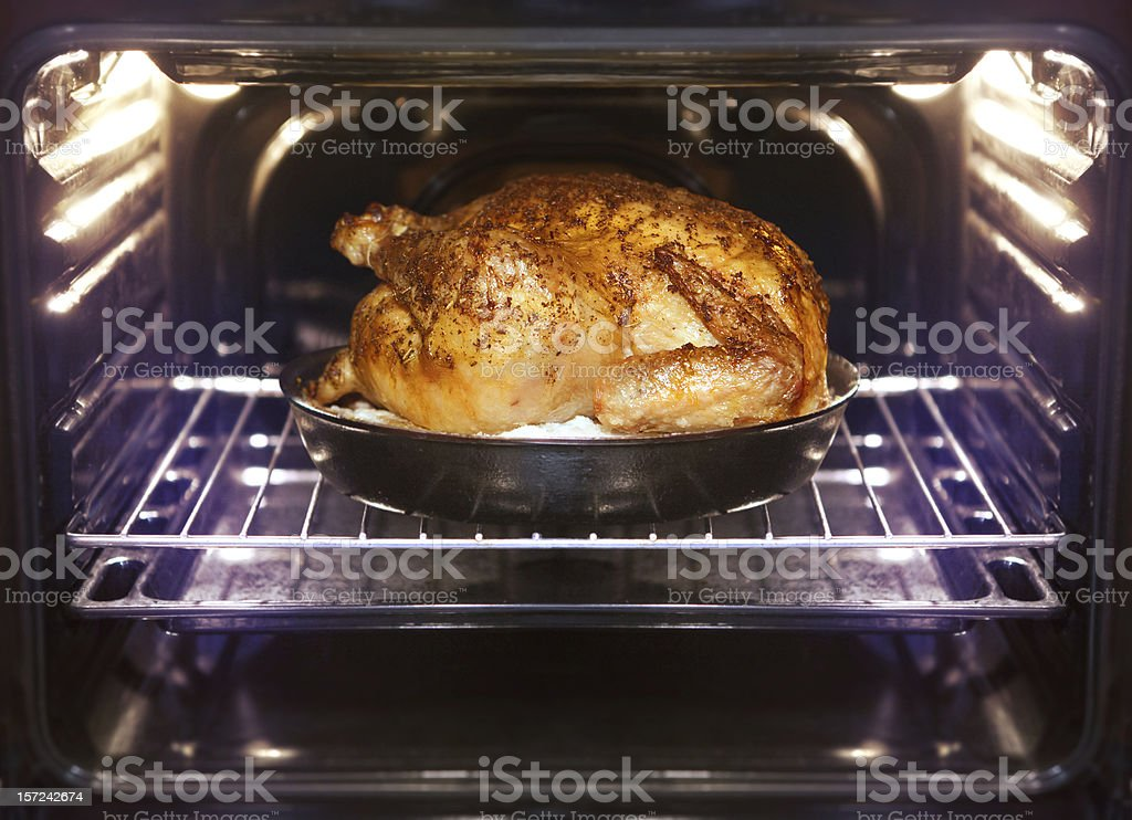 turkey is baked in oven stock photo