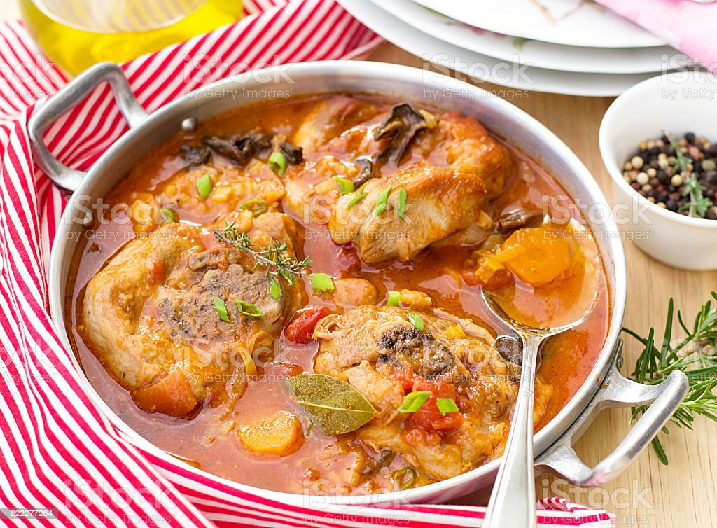 Turkey ossobuco osso bucco in tomato gravy with mushrooms stock photo