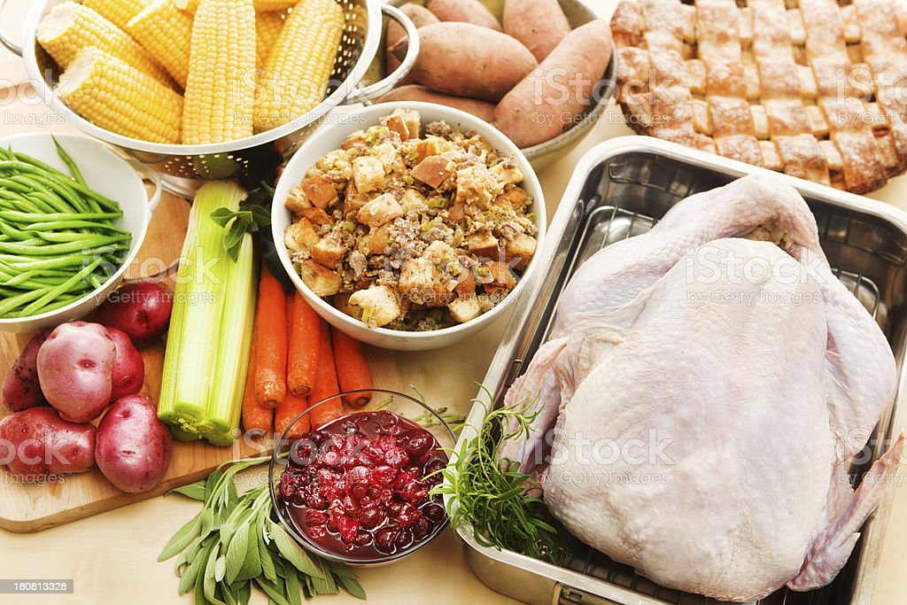 Turkey & Raw Ingredients for Thanksgiving Dinner Preparation Horizontal royalty-free stock photo