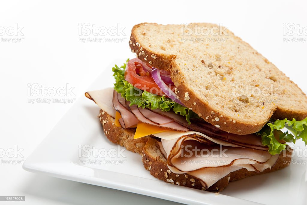 Turkey sandwich on white background stock photo