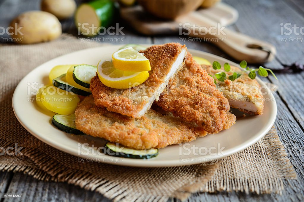 Turkey schnitzel with potato and zucchini stock photo