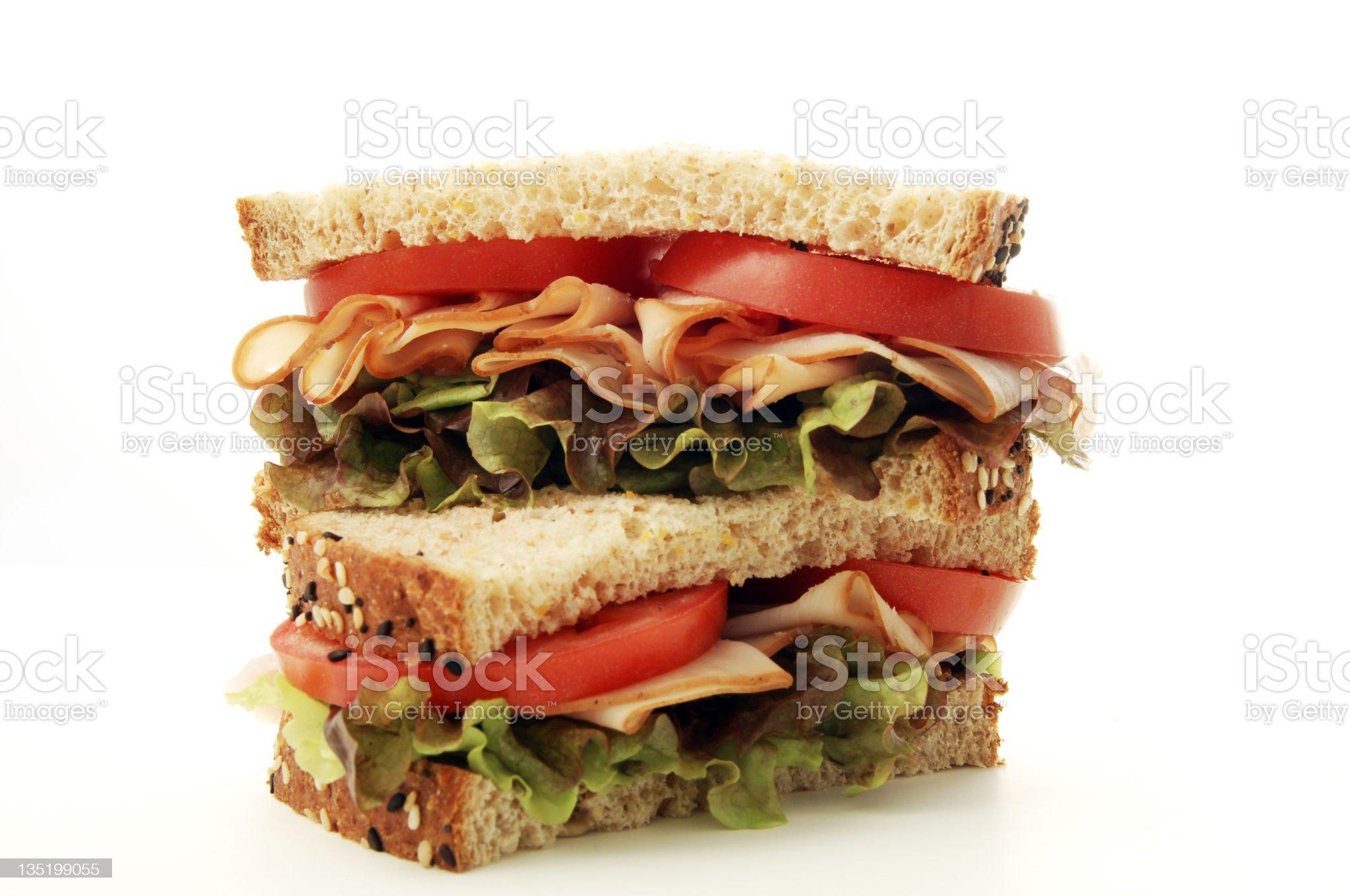 Turkey, tomato and lettuce sandwich in granary bread royalty-free stock photo