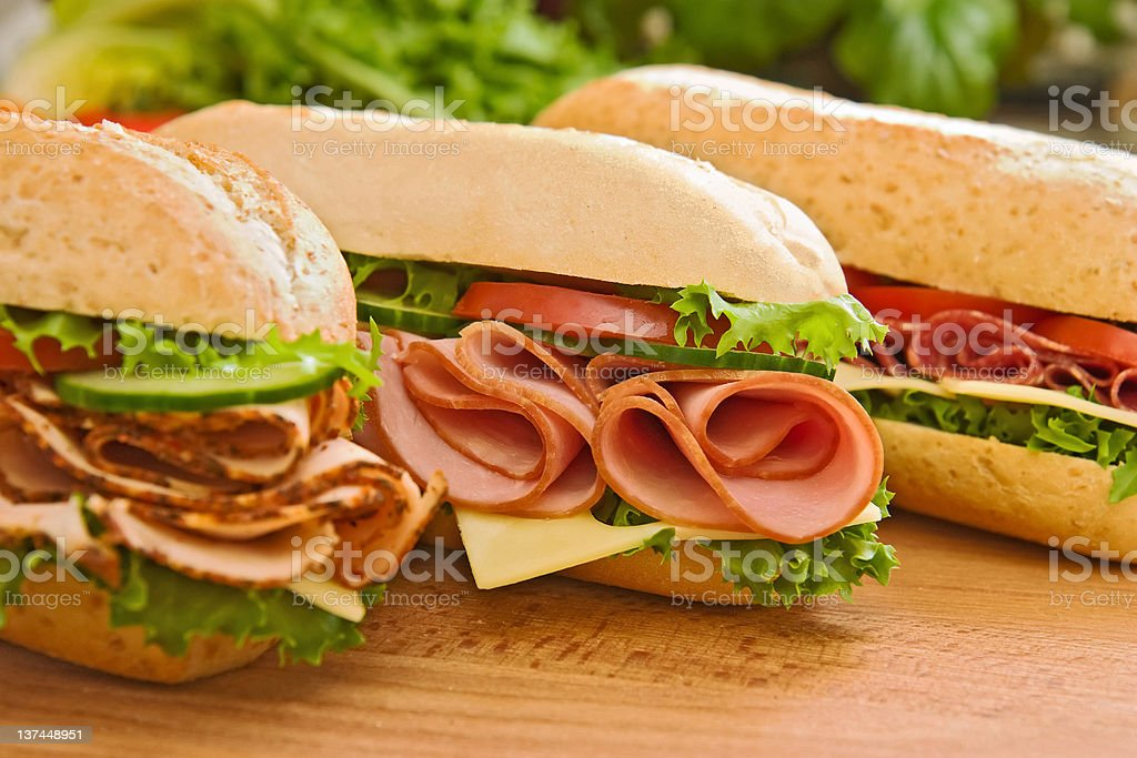 Turkey/chicken breast, ham & swiss and salami sandwiches stock photo