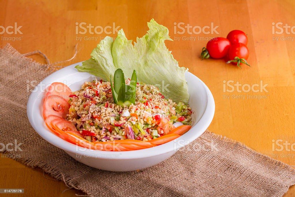 Turkish and Arabic Traditional Salad Gavurdagı on wood table stock photo