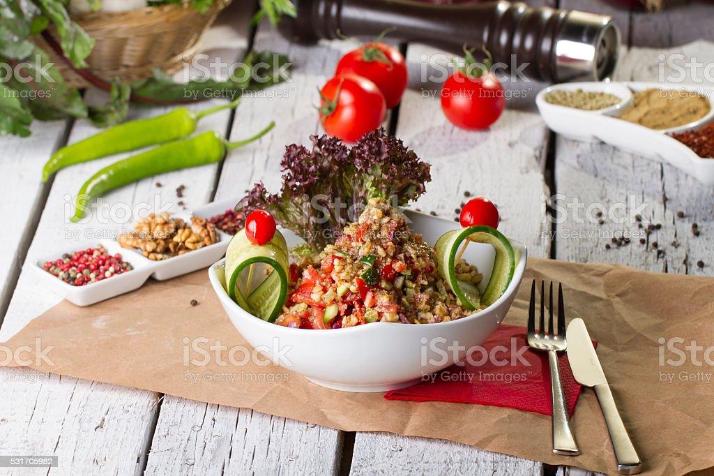 Turkish and Arabic Traditional Salad Gavurdagi on wood table stock photo
