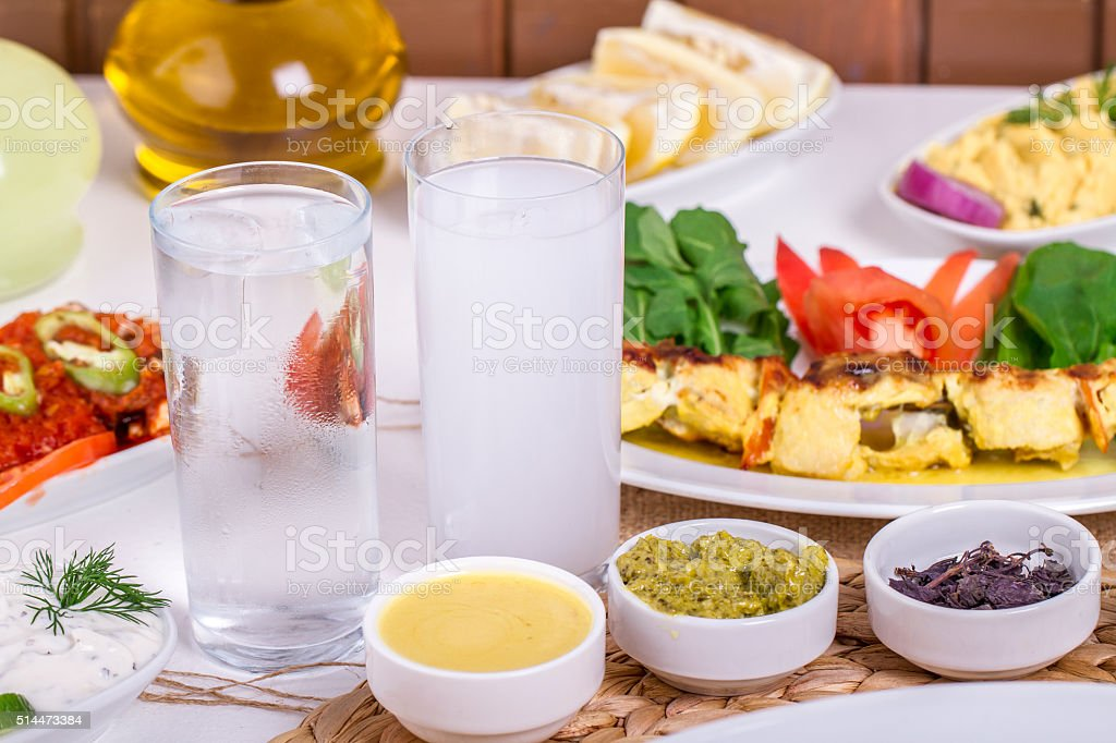 Turkish and Greek traditional rustic dinner table with raki, ouzo stock photo