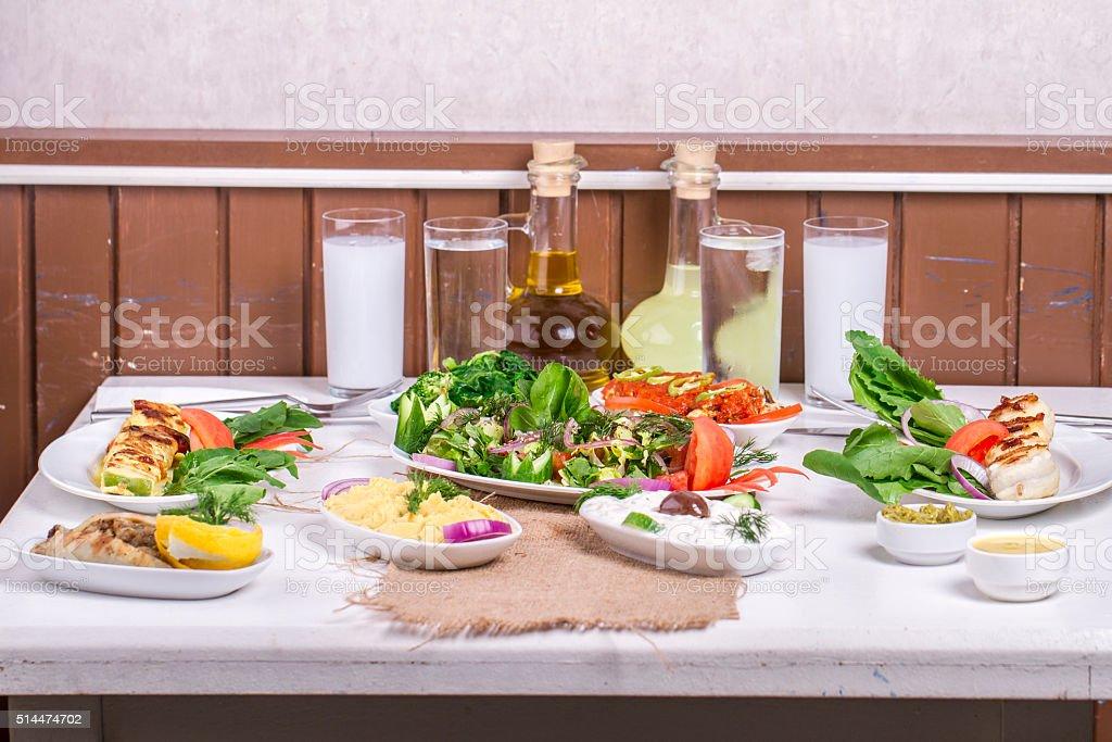 Turkish and Greek traditional rustic dinner table with raki, ouzo stock photo