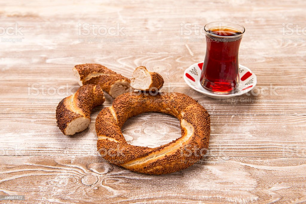 turkish bagel, simit and tea on wooden table stock photo