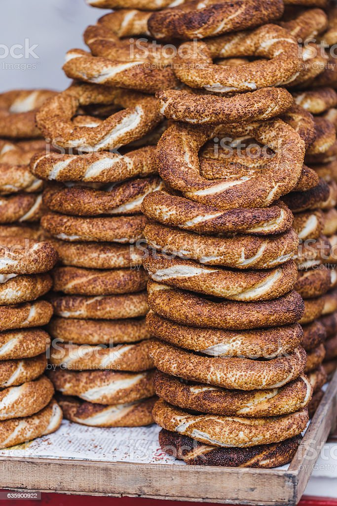 Turkish bagel simit close up. Fresh baked pastries for sale stock photo