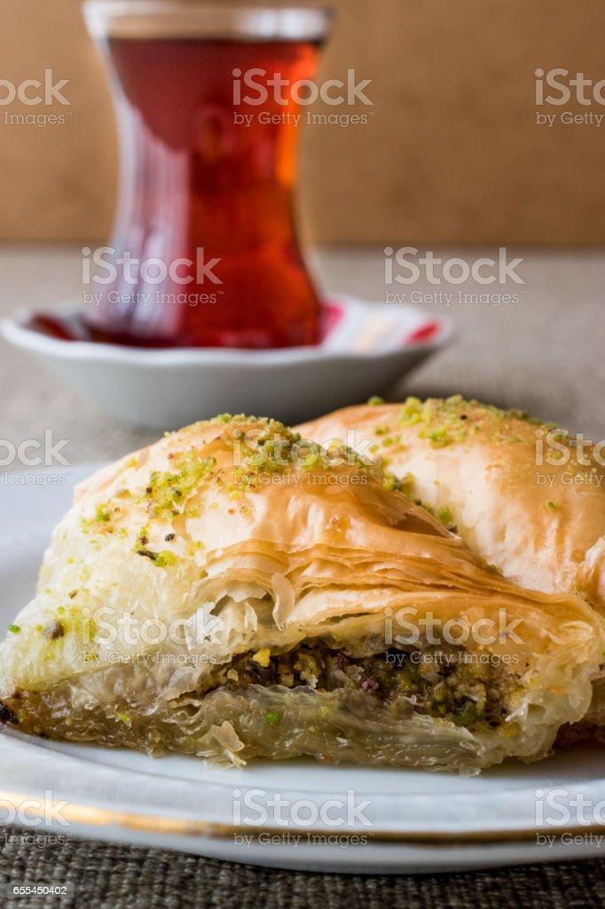 Turkish Baklava sobiyet with pistachio and tea. stock photo