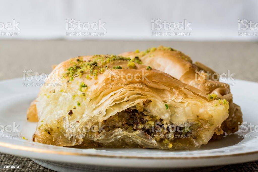 Turkish Baklava sobiyet with pistachio. stock photo