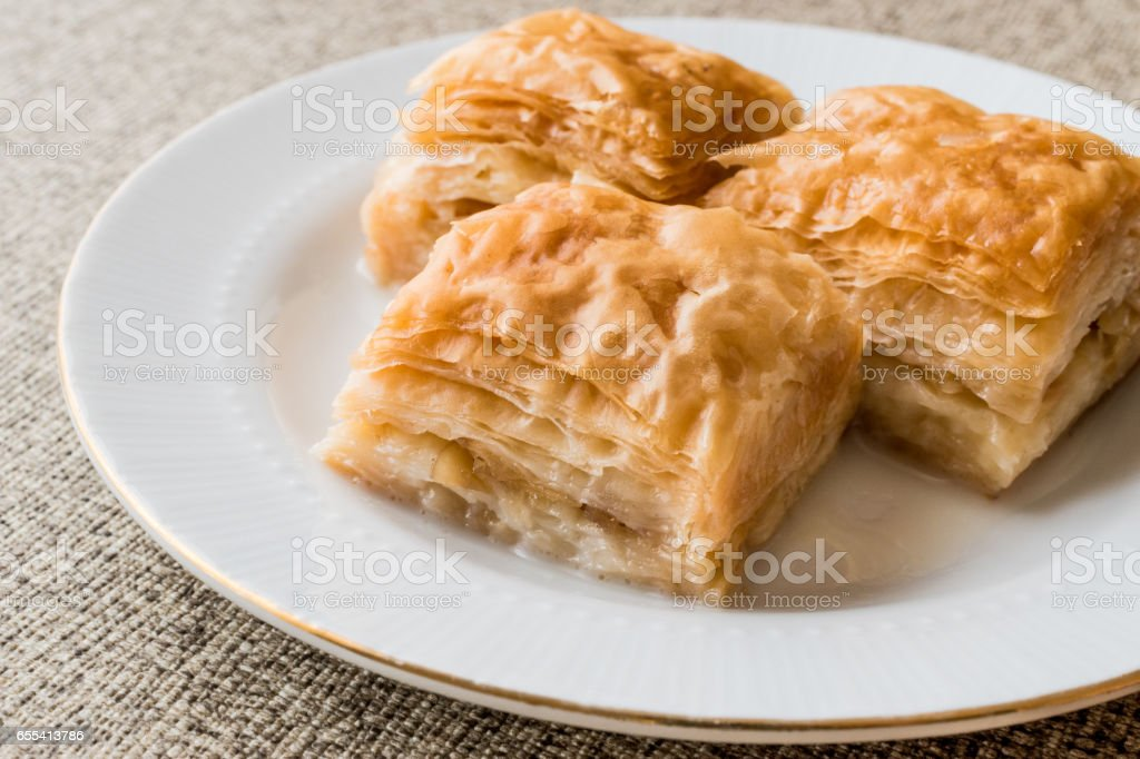 Turkish Baklava sutlu nuriye with milk and hazelnuts. stock photo