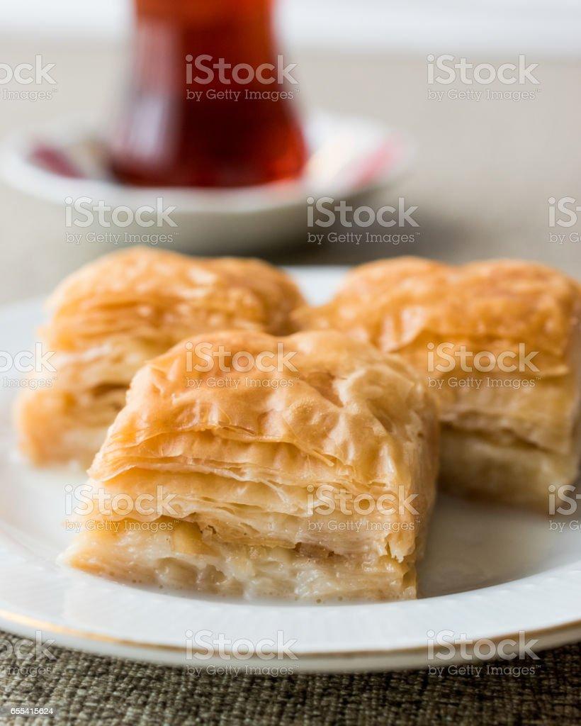 Turkish Baklava Sutlu Nuriye with tea. stock photo