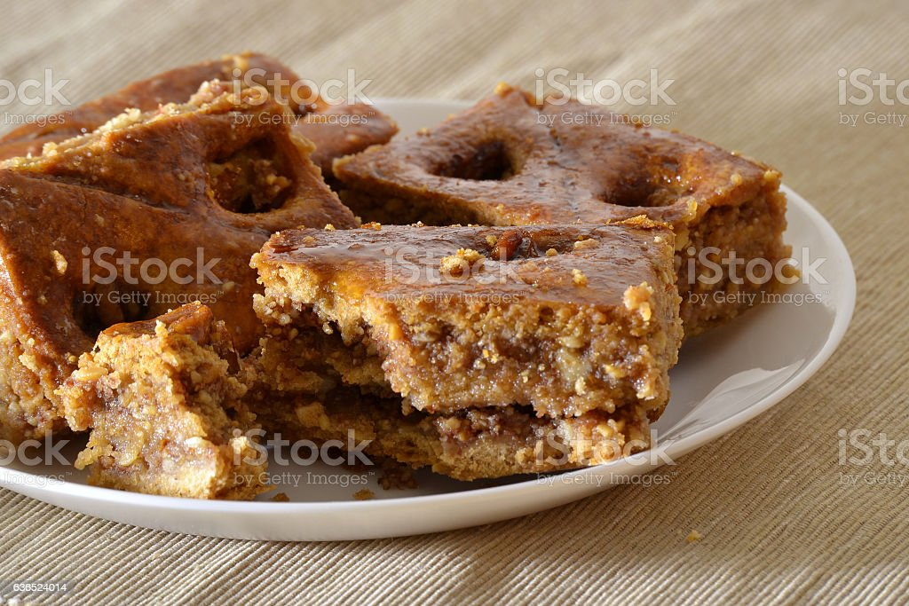 Turkish baklava with walnuts on a white plate stock photo