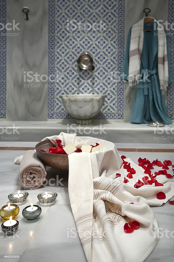 Turkish bath scene with lush towels and lighted candles stock photo