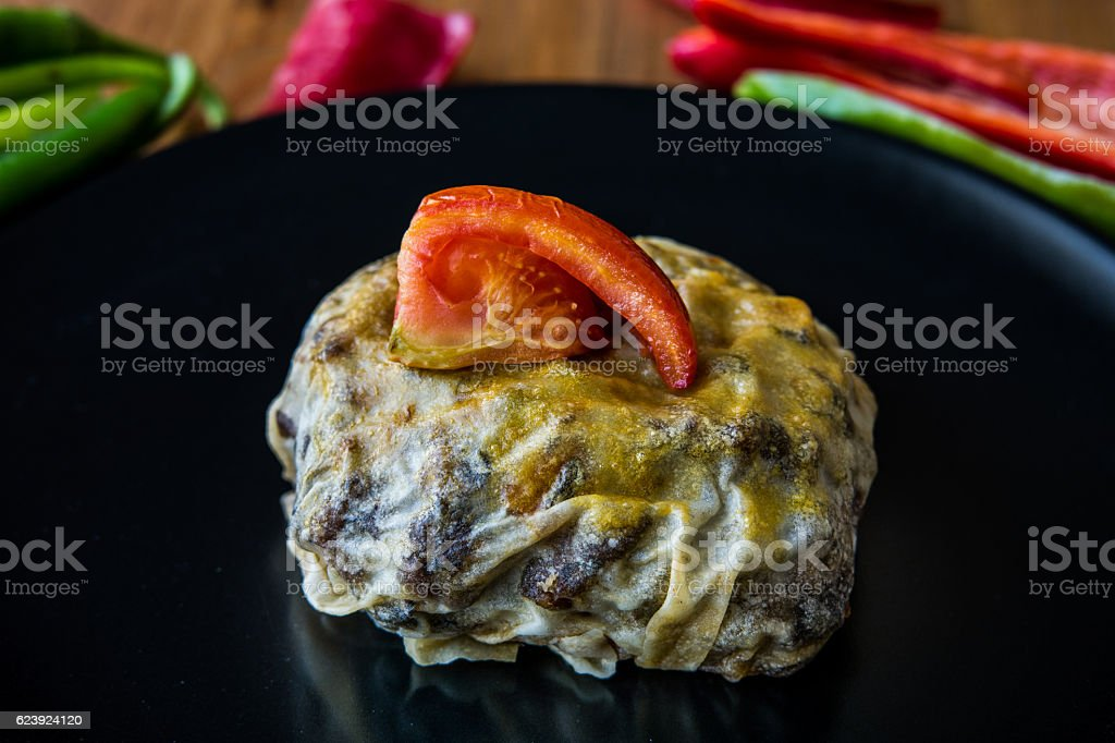 Turkish Bohca Kebab / Crepe with Cubed Meatball and Vegetables. stock photo
