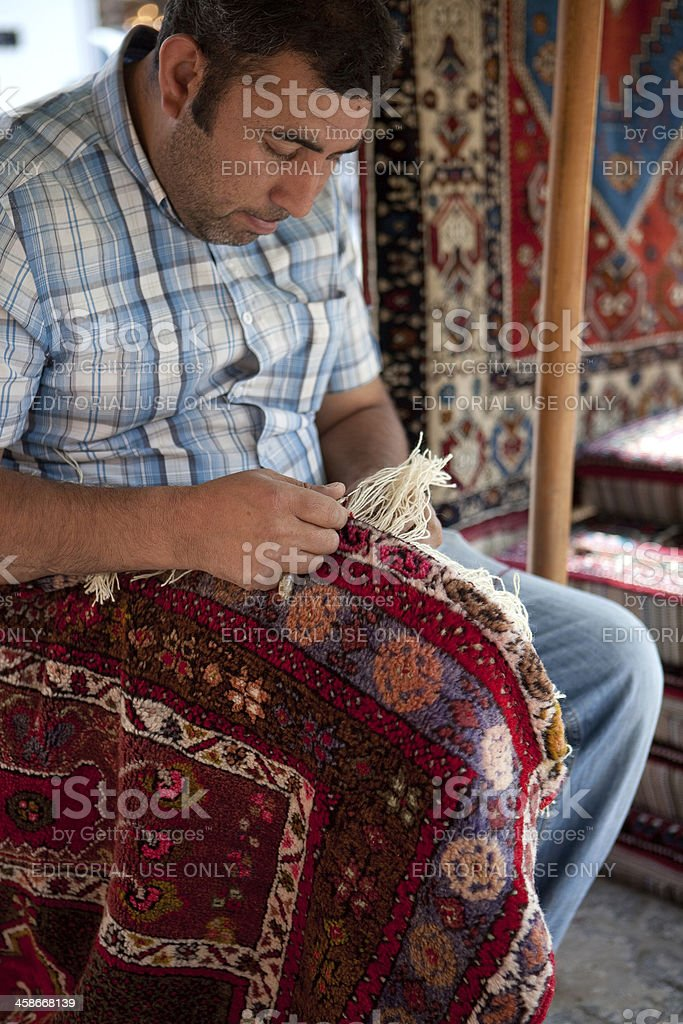 Turkish carpet restoration royalty-free stock photo