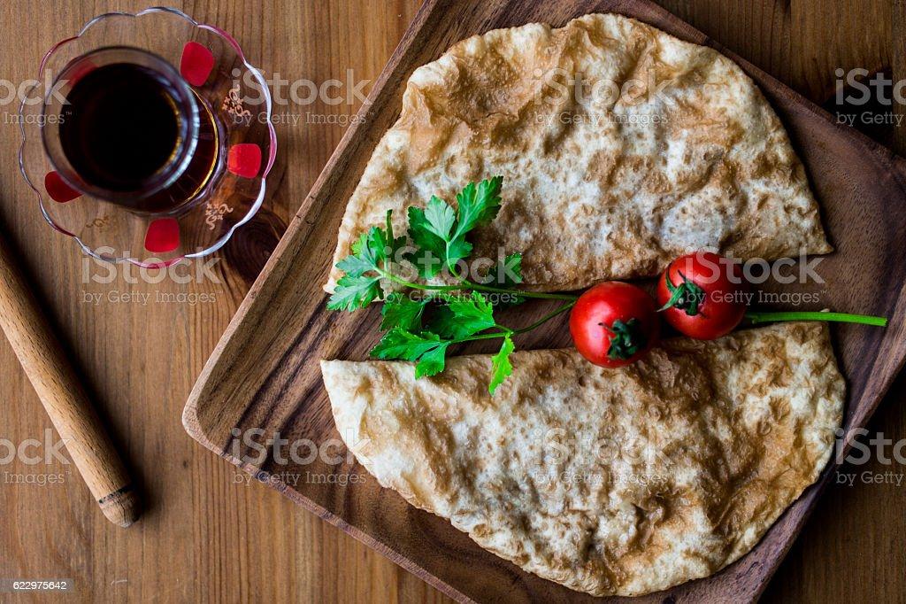 Turkish Cig Borek / Tatar Pie with tea. stock photo