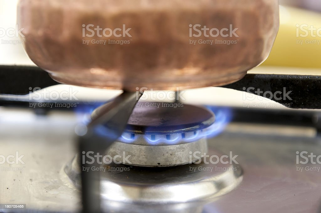 Turkish Coffee Pot (Cezve) being cooking on gas stove royalty-free stock photo