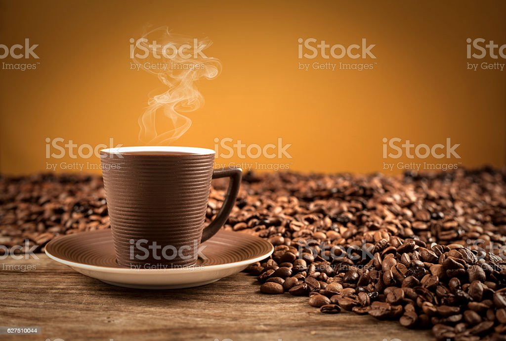 Turkish coffee with beans on brown background stock photo