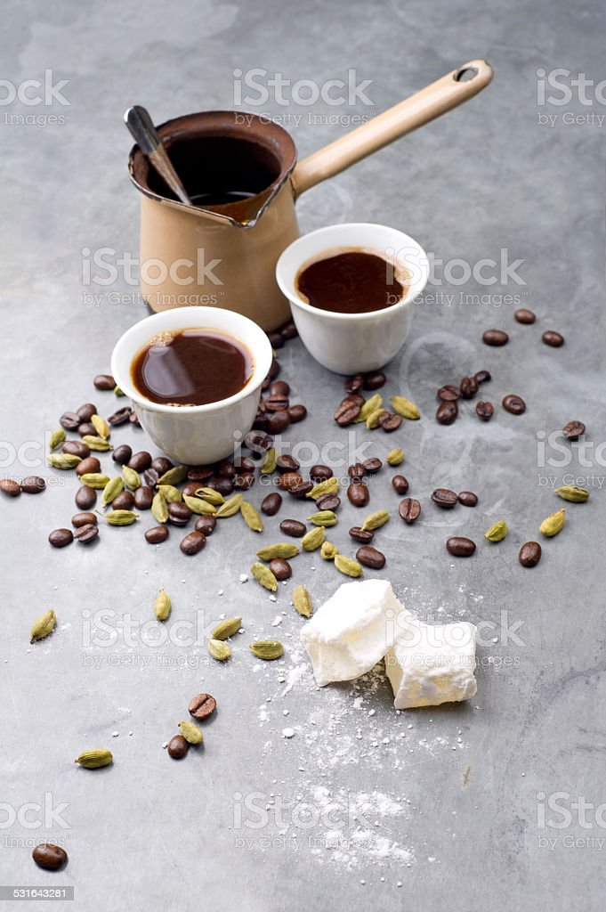 Turkish Coffee with coffee beans and Cardamom scattered stock photo