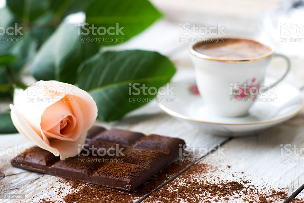 Turkish coffee with peach-colored rose and slices of chocolate stock photo