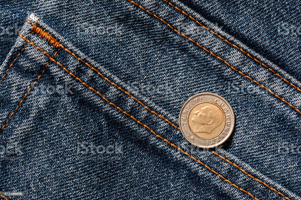 Turkish coin in jeans pocket stock photo
