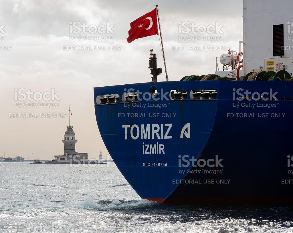 Turkish container ship passing bosphorus - Maidens Tower stock photo