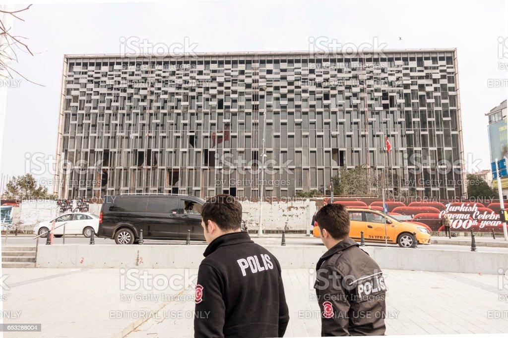 Turkish cops walking Ataturk Culture Center (AKM) in Taksim square in Istanbul stock photo