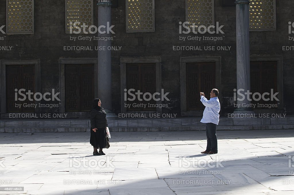 Turkish Couple Taking Photos Blue Mosque Istanbul Courtyard royalty-free stock photo