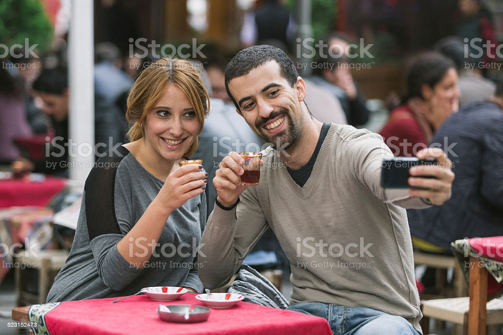 Turkish Couple Taking Selfie while Drinking Cay, Traditional Tea stock photo
