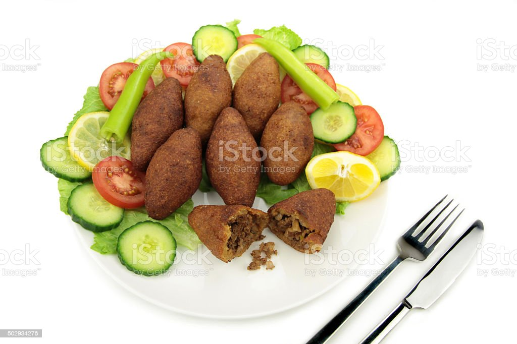 Turkish cuisine, bulgur coated meatballs - ( icli kofte ) stock photo