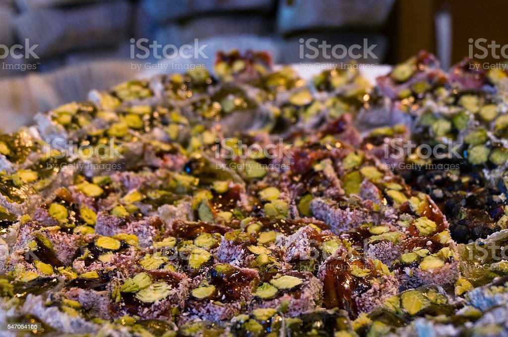 Turkish delight dessert with pistachio in coconut coating stock photo